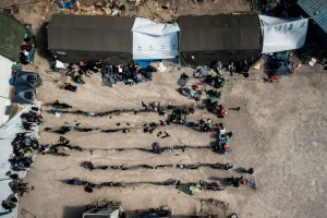 Refugees and migrants rest at the private funded camp OXY outside the town Molyvos on Lesbos, Greece on the 1. November 2015. The island have received hundreds of thousands of migrants and refugees in 2015, but have received little official help, nor established a reception center on the north coast where most arrive. This private funded camp make sure the migrants doesn't have to walk the almost 60 km to the receptioncenter outside Mytilini city.
