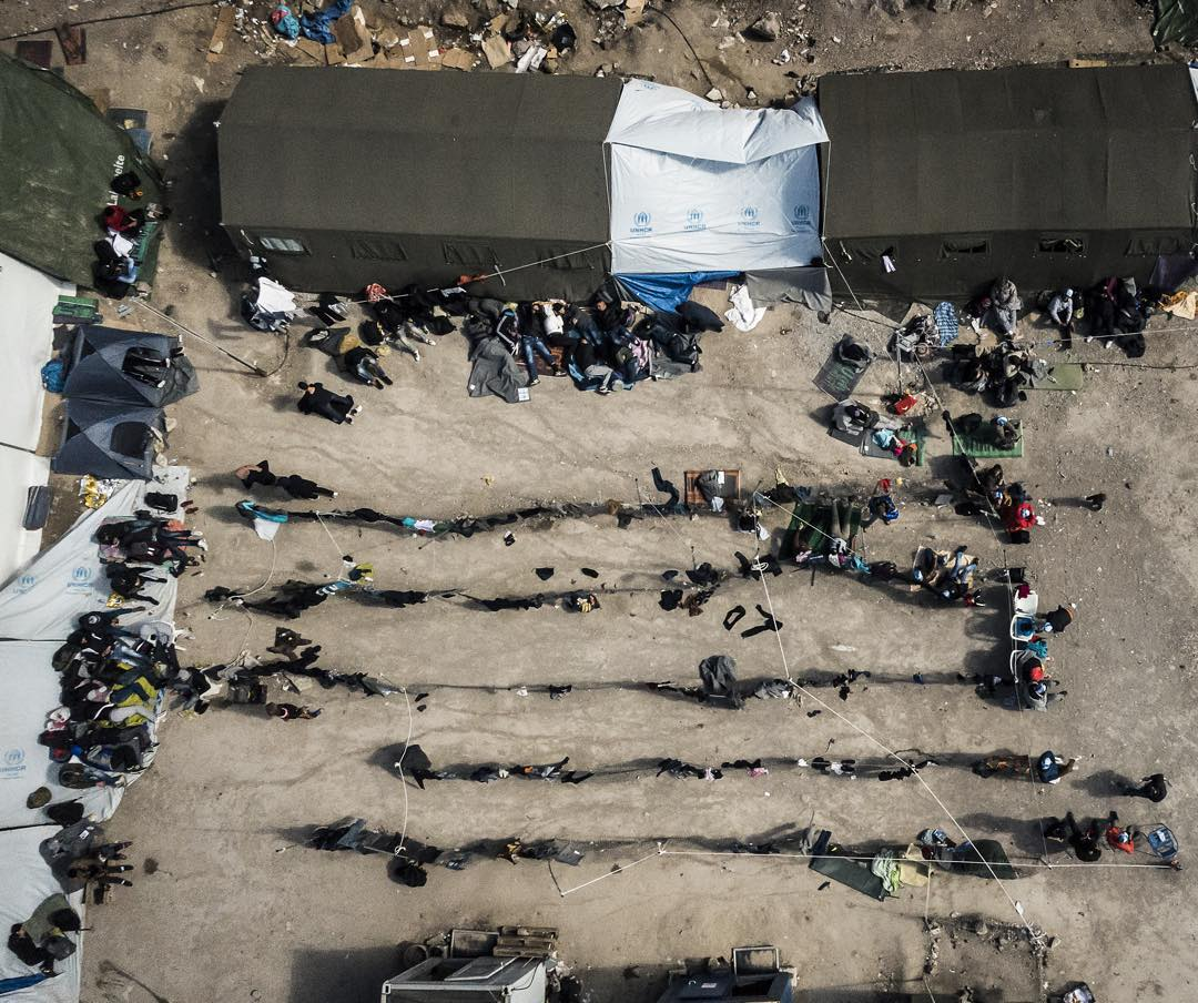 Refugees and migrants rest at the private funded OXY Camp on Lesvos, Greece
