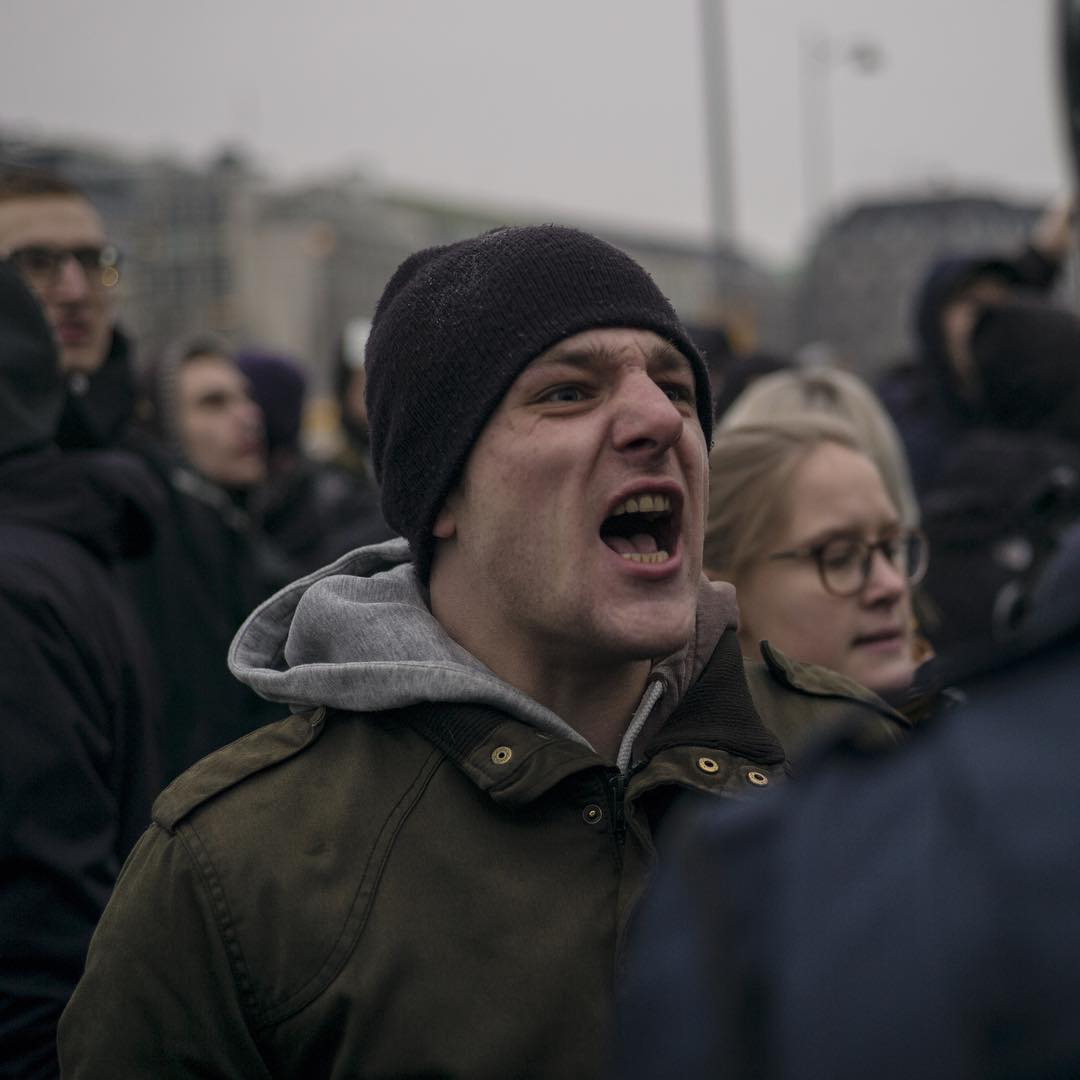 """A young man shouts """"fascists"""" towards the Pegida demonstration today in Copenhagen"""