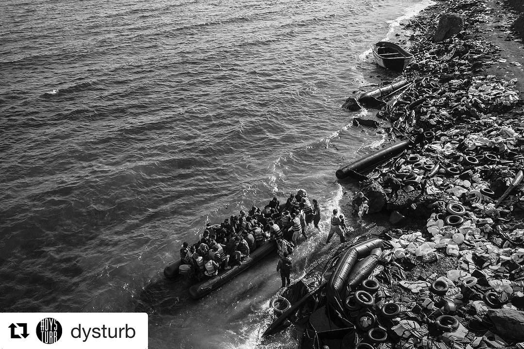 @dysturb ・・・ @rasmusdegnbol is one of the numerous photographer covering the & in. Last week, when we were in, we pasted this image from his reportage, which shows a dinghy arriving on the coast of. If you're in the city, be sure to visit @fotografiskcenter to see the large format installation of his photograph. The caption of this image, Greece. October 30, 2015. A small rubber dinghy filled with and arrives on the coast of Lesbos. This Greek island has seen hundreds of thousands of migrants and refugees arrive from in 2015. ____________________________________________ @cphartweek